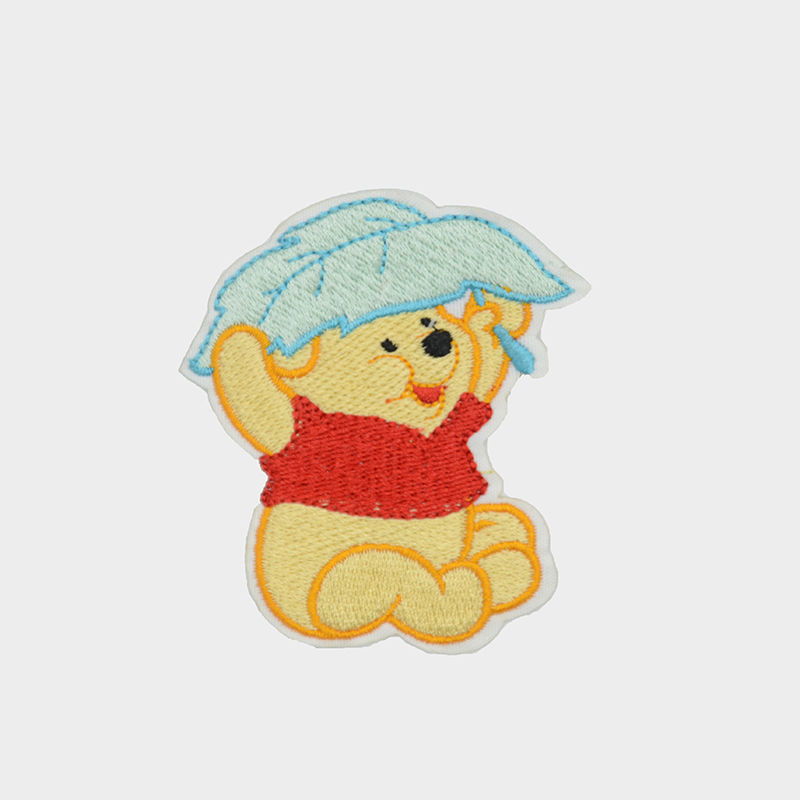 Wholesale t shirt custom badge design winnie the pooh pattern woven embroidery patch transfers